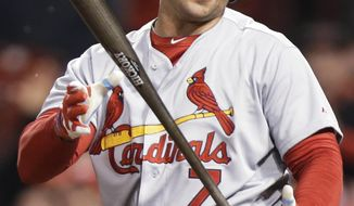 St. Louis Cardinals' Matt Holliday reacts so striking out against Cincinnati Reds relief pitcher J.J. Hoover in the ninth inning of a baseball game, Thursday, April 3, 2014, in Cincinnati. Cincinnati won 1-0. (AP Photo/Al Behrman)