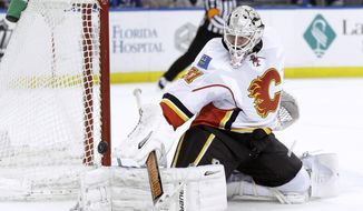 Calgary Flames goalie Karri Ramo (31), of Finland, makes a save on a shot by the Tampa Bay Lightning during the second period of an NHL hockey game on Thursday, April 3, 2014, in Tampa, Fla. (AP Photo/Chris O'Meara)