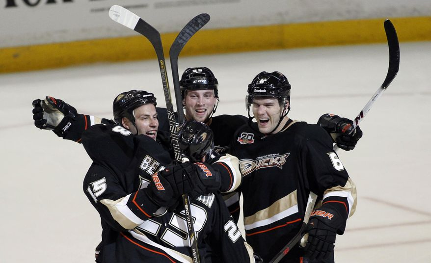Anaheim Ducks center Ryan Getzlaf (15), left wing Matt Beleskey, center, and defenseman Ben Lovejoy hug and celebrate a goal by defenseman Francois Beauchemin (23) during the third period of an NHL hockey game against Edmonton Oilers Wednesday, April 2, 2014, in Anaheim, Calif. The Ducks won 3-2. (AP Photo/Alex Gallardo)