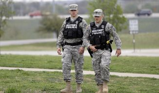 Military police patrol near Fort Hood's main gate, Thursday, April 3, 2014, in Fort Hood, Texas. A soldier, Spc. Ivan Lopez, opened fire Wednesday on fellow service members at the Fort Hood military base, killing three people and wounding 16 before committing suicide. (Associated Press) **FILE**