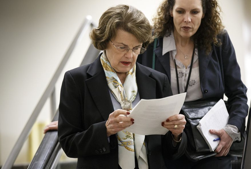 Senate Intelligence Committee Chair Sen. Dianne Feinstein, D-Calif., heads to closed-door meeting on Capitol Hill in Washington, Thursday, April 3, 2014, as the panel votes to approve declassifying part of a secret report on Bush-era interrogations of terrorism suspects puts the onus on the CIA and a reluctant White House to speed the release of one of the most definitive accounts about the government's actions after the 9/11 attacks. Members of the intelligence community raised concerns that the committee failed to interview top spy agency officials who had authorized or supervised the brutal interrogations. (AP Photo/J. Scott Applewhite)