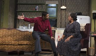 "This image released by Philip Rinaldi Publicity shows Denzel Washington, left, and LaTanya Richardson Jackson during a performance of ""A Raisin in the Sun,"" at the Ethel Barrymore Theatre in New York. (AP Photo/Philip Rinaldi Publicity, Brigitte Lacombe)"