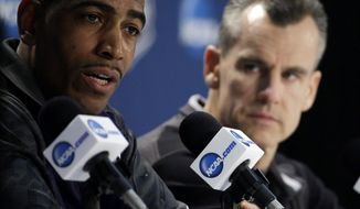 Connecticut head coach Kevin Ollie, left, and Florida head coach Billy Donovan participate in a joint news conference for their NCAA Final Four tournament college basketball semifinal game Thursday, April 3, 2014, in Dallas. Connecticut plays Florida on Saturday, April 5, 2014. (AP Photo/David J. Phillip)
