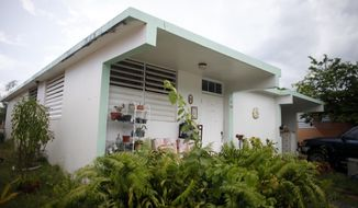 The house where the soldier, Spc. Ivan Lopez grew up is seen in Guayanilla, Puerto Rico, Thursday, April 3, 2014. Lopez, opened fire Wednesday on fellow service members at the Fort Hood military base, killing three people and wounding 16 before committing suicide. (AP Photo/Ricardo Arduengo)