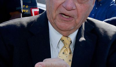Maricopa County Sheriff Joe Arpaio talks about inmate Andrew Ward who was arrested on suspicion of first-degree murder in the Wednesday night killing of cellmate Douglas Walker in a Maricopa County jail, after a news conference, Thursday, April 3, 2014, in Sun City, Ariz. (AP Photo/Ross D. Franklin)