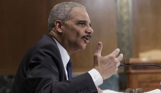 ** FILE ** Attorney General Eric Holder testifies on Capitol Hill in Washington, Thursday, April 3, 2014, before a Senate Appropriations subcommittee hearing on proposed budget estimates for fiscal year 2015 for the Justice Department. (AP Photo/J. Scott Applewhite)