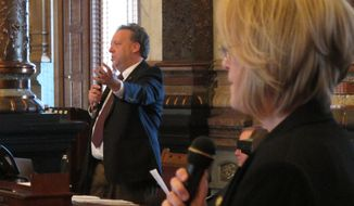 Kansas state Sen. Tom Holland, left, a Baldwin City Democrat, criticizes a bill to bring Kansas into a compact with other states looking to avoid the federal health care overhaul during a debate, Friday, April 4, 2014, at the Statehouse in the Senate, in Topeka, Kan. Debating him is Sen. Mary Pilcher-Cook, right, a Shawnee Republican who strongly supports the measure. (AP Photo/John Hanna)