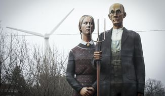 Seward Johnson's American Gothic-inspired statue is on display at the Iowa State Fairgrounds in Des Moines, Iowa., on Jan. 19, 2014.   The  25-foot-tall replica of the farmer and daughter shown in the painting will remain at the fairgrounds in east Des Moines for the next six months.  Peter Cownie, executive director of the Iowa State Fair Blue Ribbon Foundation, said his father, Jim Cownie, and central Iowa businessman Bill Knapp paid $30,000 to lease the sculpture. (AP Photo/The Des Moines Register, Rodney White) MANDATORY CREDIT