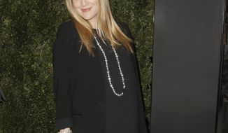 "FILE - In this Jan. 14, 2014 file photo, Drew Barrymore arrives at the Chanel Dinner celebrating the release of Drew Barrymore's new book ""Find It In Everything"" at the Chanel Boutique in Beverly Hills, Calif. The 39-year-old, who is expecting her second daughter with husband Will Kopelman any day now, is joining other famous families at Safe Kids Day, an educational playdate that raises funds and awareness of preventable childhood injuries. Gwen Stefani and Gavin Rossdale, Mark Wahlberg, Piers Morgan, Kelsey Grammer and Ciara are among the celebrities expected at the Los Angeles event Saturday, April 5, 2014.  (Photo by Todd Williamson/Invision/AP, file)"