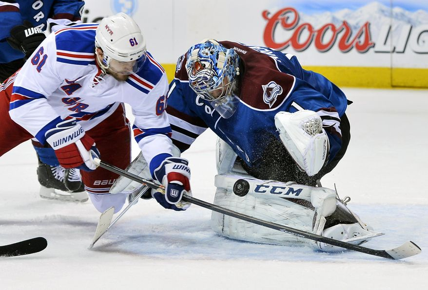Colorado Avalanche goalie Semyon Varlamov (1), of Russia, blocks a shot by New York Rangers left wing Rick Nash (61) during the second period of an NHL hockey game on Thursday, April 3, 2014, in Denver. (AP Photo/Jack Dempsey)