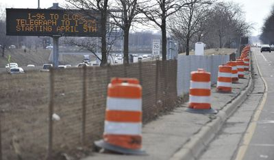 Signs on westbound I-96 near Farmington Road in Livonia, Mich., warn commuters about closings for construction work on April 1, 2014.  The Michigan Department of Transportation says a several-mile stretch of Interstate 96 in Livonia and Wayne County's Redford Township is being shut down Saturday, weather permitting. The $148 million project to rebuild the roadway also includes bridge repair and replacement work. Details are posted on a website for the project. (AP Photo/Detroit News, Robin Buckson)