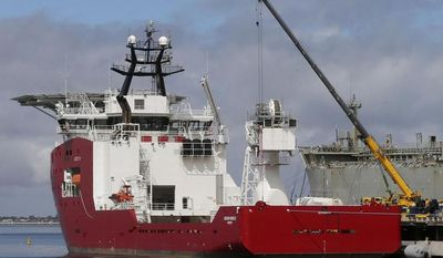** FILE ** In this Sunday, March 30, 2014, file photo, the Australian navy ship Ocean Shield lies docked at naval base HMAS Stirling while being fitted with a towed pinger locator to aid in her roll in the search for missing Malaysia Airlines Flight MH370 in Perth, Australia. (AP Photo/Rob Griffith, File)