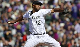Colorado Rockies starting pitcher Juan nicasio works against the Arizona Diamondbacks in the fourth inning of a baseball game in Denver on Friday, April 4, 2014. (AP Photo/David Zalubowski)