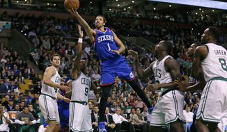 Philadelphia 76ers guard Michael Carter-Williams (1) drives through the Boston Celtics for a basket during the second half of an NBA basketball game Friday, April 4, 2014, in Boston. Carter-Williams had 24 points in the 76ers' 111-102 win. (AP Photo/Charles Krupa)