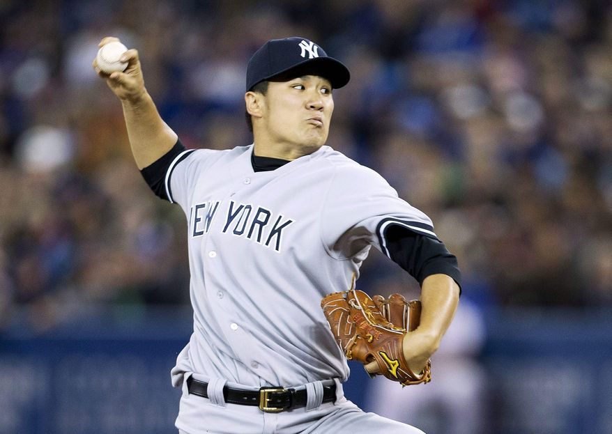 New York Yankees starting pitcher Masahiro Tanaka of Japan makes his major league debut as he pitches against the Toronto Blue Jays during first inning AL baseball action in Toronto on Friday, April 4, 2014. (AP Photo/The Canadian Press,Nathan Denette)
