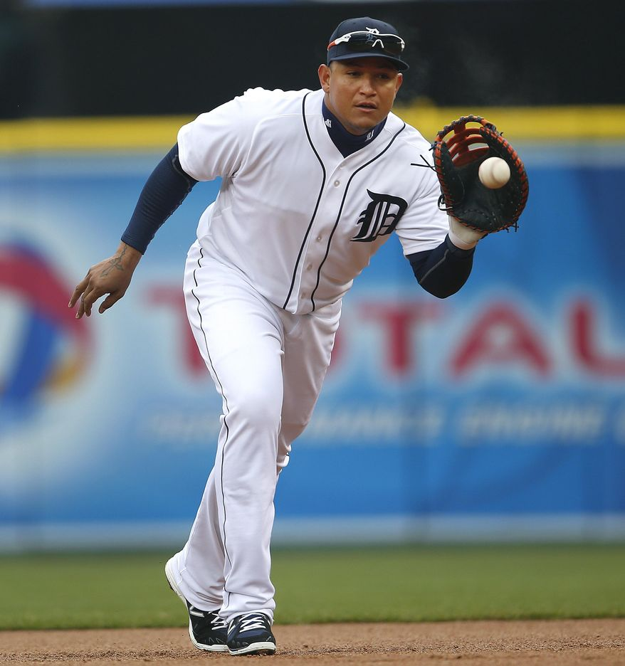 Detroit Tigers first baseman Miguel Cabrera fields a Baltimore Orioles' Nick Markakis ground ball for an out in the first inning of a baseball game in Detroit, Friday, April 4, 2014. (AP Photo/Paul Sancya)