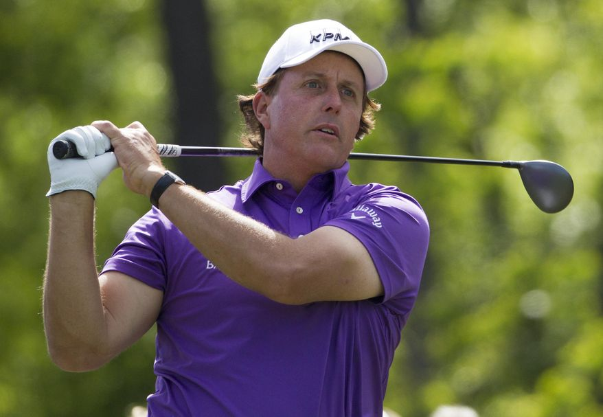 Phil Mickelson tees off on the 12th hole during the second round of the Houston Open golf tournament on Friday, April 4, 2014, in Humble, Texas. (AP Photo/Patric Schneider)