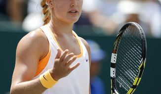 Eugenie Bouchard, of Canada, gestures during her match against Jelena Jankovic, of Serbia, during the Family Circle Cup tennis tournament in Charleston, S.C., Friday, April 4, 2014. (AP Photo/Mic Smith)