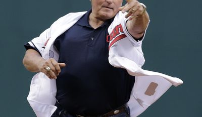 Former Cleveland Indians manager Mike Hargrove throws out the ceremonial first pitch before a baseball game between the Minnesota Twins and the Cleveland Indians, Friday, April 4, 2014, in Cleveland. (AP Photo/Mark Duncan)