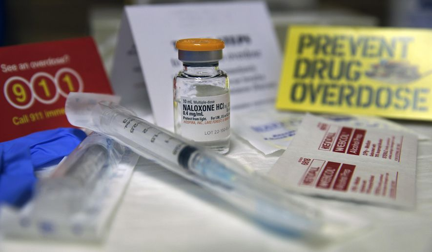 """A kit with naloxone, also known by its brand name Narcan, is displayed at the South Jersey AIDS Alliance in Atlantic City, N.J., on Feb. 19, 2014. An overdose of opiates essentially makes the body forget to breathe. Naloxone works by blocking the brain receptors that opiates latch onto and helping the body """"remember"""" to take in air. (Associated Press) **FILE**"""