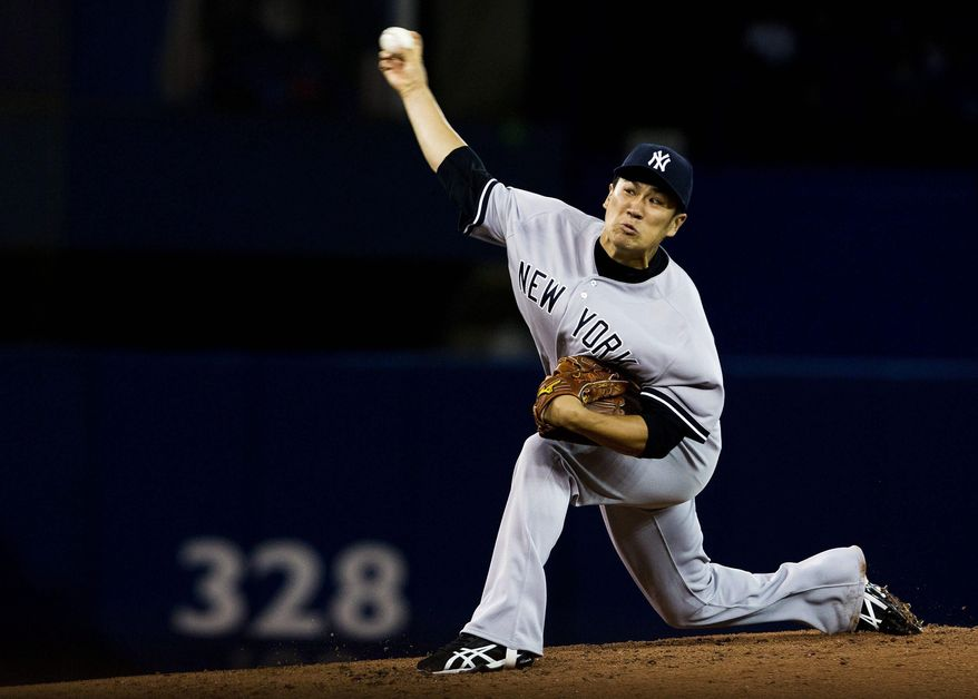 New York Yankees starting pitcher Masahiro Tanaka makes his major league debut as he pitches against the Toronto Blue Jays during second inning AL baseball action in Toronto on Friday, April 4, 2014.(AP Photo/The Canadian Press,Peter Power)