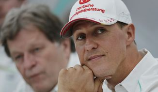 "FILE - This is a Thursday, Oct. 4, 2012 file photo of  Mercedes driver Michael Schumacher, right, of Germany sits with teammate Norbert Haug,  during a news conference to announce his retirement from Formula One at the end of the 2012  in Suzuka, Japan.  Michael Schumacher's manager said Friday April 4, 2014 that the retired Formula One star now ""shows moments of consciousness and awakening,"" more than three months after suffering serious head injuries in a skiing accident. Manager Sabine Kehm said in a statement that ""Michael is making progress on his way."" She added that ""we keep remaining confident."" (AP Photo/Shizuo Kambayashi, File)"