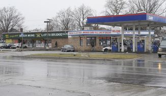 Cars enter local business at the scene of an attack on Wednesday at the street corners of Morang and Balfour on Thursday, April 3, 2014 in Detroit. A suburban Detroit man was in critical condition Thursday with severe head injuries after a neighborhood mob beat and kicked him when he stopped to check on a 10-year-old boy who stepped from a curb into the path of his pickup. The 54-year-old man, whose name was not released, was being treated at a Detroit hospital as police scoured the east side neighborhood where he was attacked Wednesday afternoon. The boy, David Harris, was expected to recover from his injuries, according to Desmond Key, who said he was the 10-year-old's uncle.  (AP Photo/Detroit News, Clarence Tabb Jr)  DETROIT FREE PRESS OUT; HUFFINGTON POST OUT