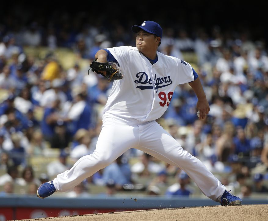 Los Angeles Dodgers starting pitcher Hyun-jin Ryu, of South Korea, throws against the San Francisco Giants during the first inning of a baseball game on Friday, April 4, 2014, in Los Angeles. (AP Photo/Jae C. Hong)