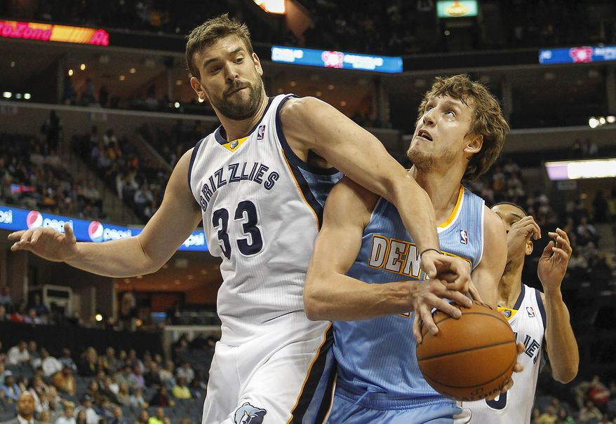 Memphis Grizzlies center Marc Gasol (33), of Spain, blocks a shot by Denver Nuggets forward Jan Vesely, of the Czech Republic, in the first half of an NBA basketball game Friday, April 4, 2014, in Memphis, Tenn. (AP Photo/Lance Murphey)