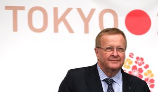 International Olympic Committee (IOC) Vice President John Coates attends the IOC/ TOKYO 2020 joint press conference in Tokyo, Friday, April 4, 2014. Coates and other IOC officials are in Tokyo for a two-day IOC-Tokyo 2020 First Project Review. (AP Photo/Eugene Hoshiko)