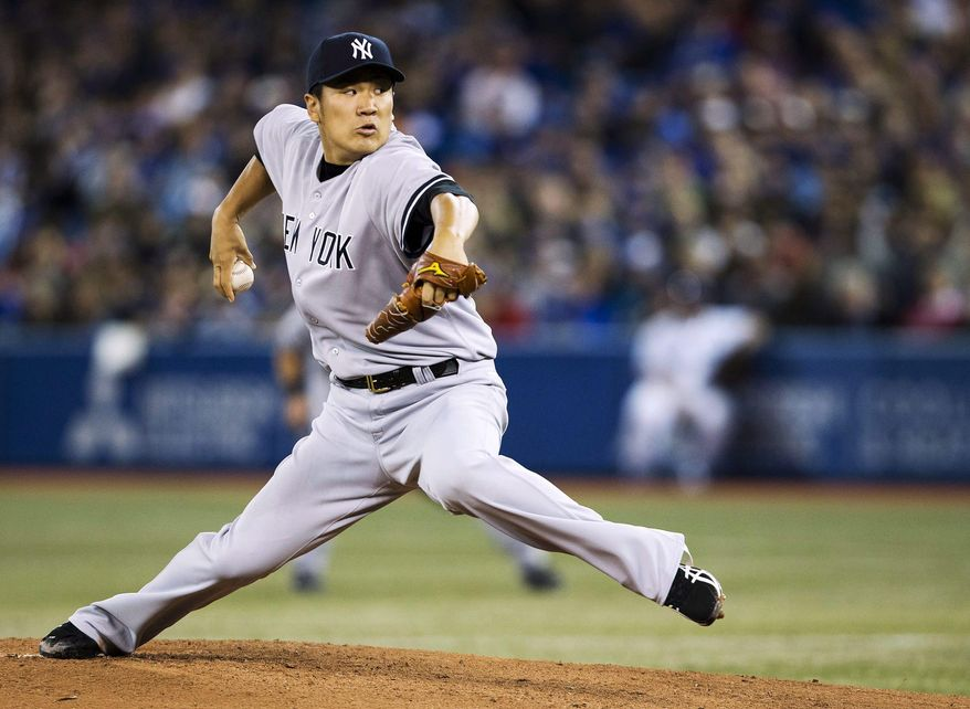 New York Yankees starting pitcher Masahiro Tanaka makes his major league debut as he pitches against the Toronto Blue Jays during first inning AL baseball action in Toronto on Friday, April 4, 2014. (AP Photo/The Canadian Press,Nathan Denette)