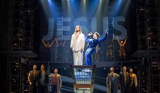 "In this theater publicity image released by Boneau/Bryan-Brown, Paul Nolan, center left, and Josh Nolan are shown with the cast during a performance of ""Jesus Christ Superstar,"" in New York. (AP Photo/Boneau/Bryan-Brown, Joan Marcus)"