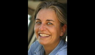 ** FILE ** In this 2003 file photo, Associated Press photographer Anja Niedringhaus poses for a photograph in Jerusalem. Niedringhaus, 48, was killed and an AP reporter was wounded on Friday, April 4, 2014, when an Afghan policeman opened fire while they were sitting in their car in eastern Afghanistan. (AP Photo, File)