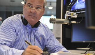 FILE - In this July 2, 2010 file photo, former Connecticut Gov. John Rowland sits in studio as a talk show host on WTIC AM radio in Farmington, Conn. Rowland resigned from office in 2004 amid a corruption scandal. He eventually was sentenced to serve time in a federal prison, but again is in the crosshairs of federal investigators. On Monday, March 31, 2014, a former Republican Congressional candidate and her husband pleaded guilty in a scheme to create a phony contract to hide the consulting role Rowland played in her campaign. (AP Photo/Jessica Hill, File)