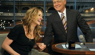 "** FILE ** In this June 9, 2009, file photo released by CBS, actress Julia Roberts laughs as she holds host David Letterman's hand on the set of the ""Late Show with David Letterman,"" in New York. (AP Photo/CBS, John Paul Filo)"