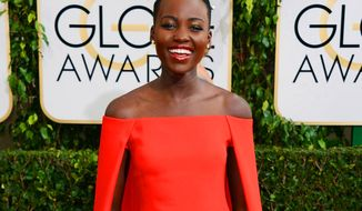 FILE - In this Jan. 12, 2014 file photo, Lupita Nyong'o arrives at the 71st annual Golden Globe Awards at the Beverly Hilton Hotel, in Beverly Hills, Calif. The Mexican-born Kenyan will be the first black ambassador for Lancome, which features Julia Roberts, Kate Winslet, Penelope Cruz and Lily Collins as spokeswomen. (Photo by Jordan Strauss/Invision/AP, File)