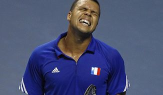French tennis player Jo-Wifried Tsonga grimaces after missing a point during his single match against German player Peter Gojowczyk, in the quarterfinals of the Davis Cup in Nancy, eastern France, Friday April 4, 2014. France plays against Germany from Friday April 4 to Sunday April 6. (AP Photo/Remy de la Mauviniere)