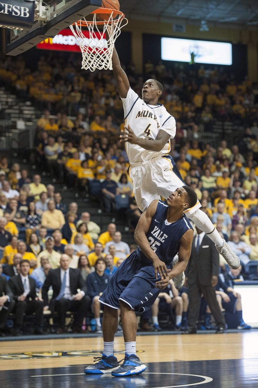 Murray State's Jarvis Williams puts a shot up over Yale's Brandon Sherrod in an NCAA college basketball game for the CollegeInsider.com tournament championship, Thursday, April 4, 2014, in Murray, Ky. (AP Photo/The Ledger, Kyser Lough)