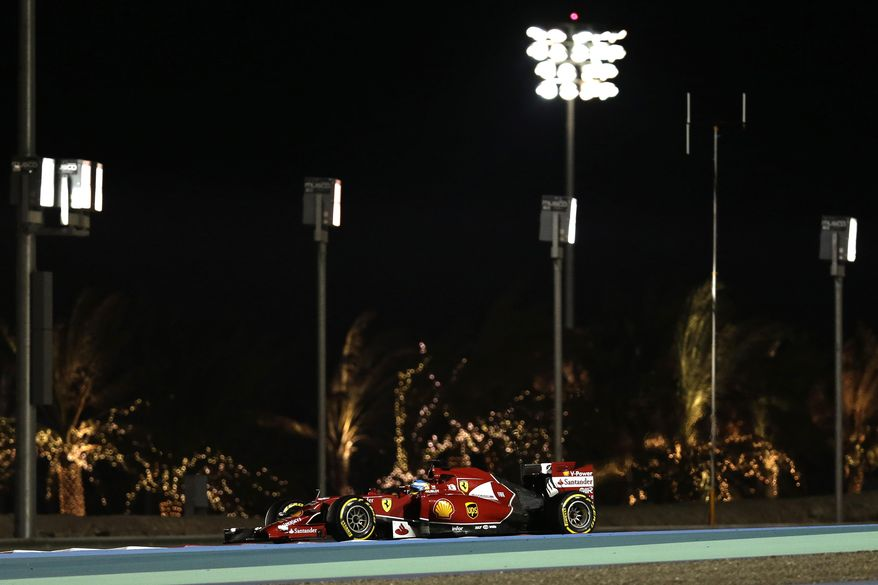 Ferrari driver Fernando Alonso of Spain steers his car during the second free practice ahead of the Bahrain Formula One Grand Prix at the Formula One Bahrain International Circuit in Sakhir, Bahrain, Friday, April 4, 2014. (AP Photo/Hassan Ammar)