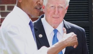 ** FILE ** Democratic Congressman Jim Moran of Virginia speaks with President Obama at a townhall meeting. (Facebook, Rep. Jim Moran)