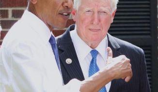 ** FILE ** Democratic Congressman Jim Moran of Virginia speaks with President Obama at a townhall meeting. (Facebook, Rep. Jim Moran)