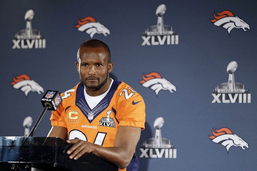 FILE - In this Jan. 29, 2014, file photo, Denver Broncos cornerback Champ Bailey listens to a question during a news conference in Jersey City, N.J. Bailey has agreed to a two-year contract with the New Orleans Saints, Friday, April 4, 2014. The 35-year-old Bailey played the last 10 seasons with Denver after spending his first five in the NFL with Washington. (AP Photo/Mark Humphrey, File)