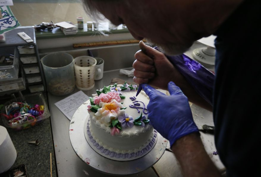 """Masterpiece Cakeshop baker Jack Phillips is again at the center of a civil rights fight after refusing to bake a cake for a same-sex wedding. Chris Sevier says Mr. Phillips must be compelled to make cakes for him and his computer """"bride."""" (Associated Press/File)"""