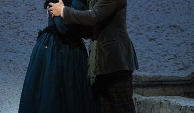 "In this photo provided by the Metropolitan Opera, Vittorio Grigolo plays Rodolfo with Kristine Opolais as Mimi in the Metropolitan Opera's Live in HD broadcast of Puccini's ""La Boheme,"" Saturday, April 5, 2014 in New York. Opolais made Metropolitan Opera history Saturday, stepping in for an ailing soprano to make her second company role debut in a span of 24 hours. On Friday night, Opolais sang Cio-Cio-San in Puccini's ""Madama Butterfly."" (AP Photo/Metropolitan Opera, Marty Sohl)"