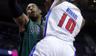 Detroit Pistons center Greg Monroe (10) is fouled by Boston Celtics forward Jared Sullinger while taking a shot during the first half of an NBA basketball game Saturday, April 5, 2014, in Auburn Hills, Mich. (AP Photo/Duane Burleson)