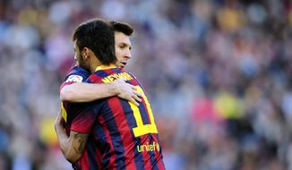 FC Barcelona's Lionel Messi, from Argentina, right, embraces to Neymar, from Brazil, during a Spanish La Liga soccer match against Betis at the Camp Nou stadium in Barcelona, Spain, Saturday, April 5, 2014. (AP Photo/Manu Fernandez)
