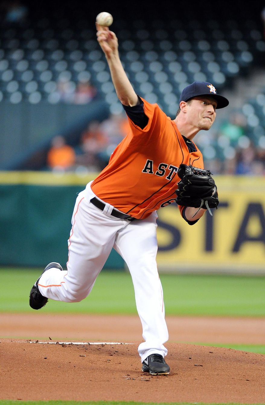 Houston Astros' Lucas Harrell delivers a pitch in the first inning of a baseball game against the Los Angeles Angels, Friday, April 4, 2014, at Minute Maid Park in Houston. (AP Photo/Eric Christian Smith)