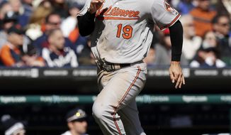 Baltimore Orioles' Chris Davis scores from first on a triple by teammate Adam Jones during the ninth inning of a baseball game against the Detroit Tigers in Detroit, Saturday, April 5, 2014. (AP Photo/Carlos Osorio)