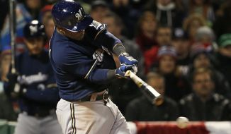 Milwaukee Brewers' Jean Segura breaks his bat on a ground-out during the sixth inning of a baseball game against the Boston Red Sox at Fenway Park in Boston, Saturday, April 5, 2014. (AP Photo/Winslow Townson)