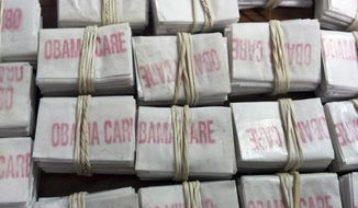 "FILE - This photo released on Friday, Dec. 20, 2013 by the Massachusetts State Police shows some of the 1,250 packets of heroin labeled ""Obamacare"" and ""Kurt Cobain"" which state police troopers confiscated during a traffic stop in Hatfield, Mass. Four people were charged with heroin trafficking. (AP Photo/Massachusetts State Police)"